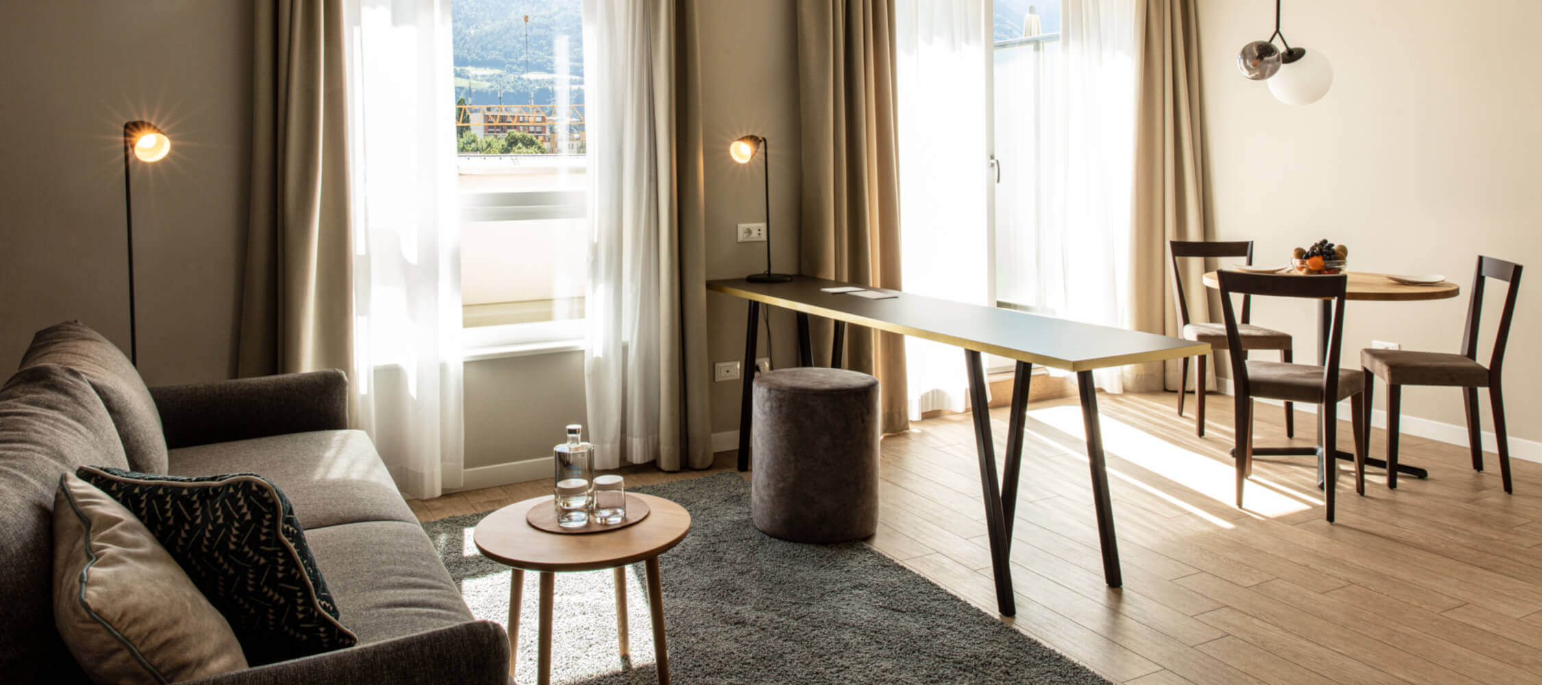 City_Hotel_Merano_Suite_Panoramic_Wohnzimmer_BeatricePilotto_3T1A1718_2250x1000