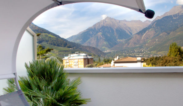City Hotel Merano, Panoramic Suite, spacious private roof terrace (15-45 m²) furnished with sunshade, loungers and table. Stunning view on landscape, avenues and historical center. Just enjoy the calming silence and a lot of privacy on the 5th floor. ©Anguane