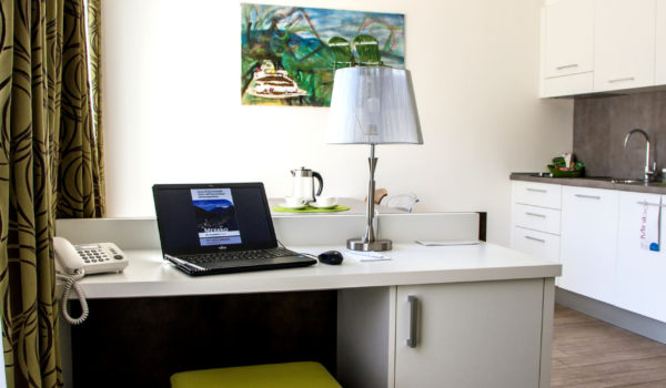 City Hotel Merano, Panoramic Suite, calming silence on the 5th floor. Work desk with direct dial telephone, WIFI internet for free, flat screen satellite TV and laptop safe. ©Anguane