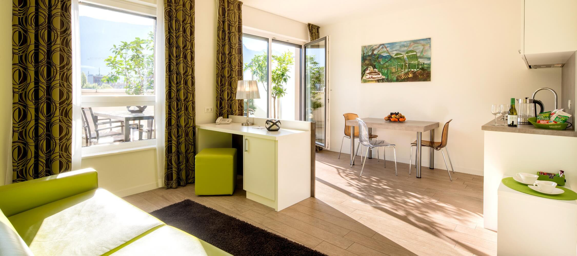 City Hotel Merano, 2-room Suite Panoramic (43-53m²), living room, spacious terrace on the 5th floor, stunning views over the rooftops of Merano