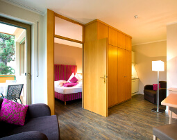 Hotel Flora, Merano, 3 stars hotel, two-room-suite Tulip, balcony, livingroom and bedroom, sing size double bed, Wifi internet for free, Sat TV, kitchenette