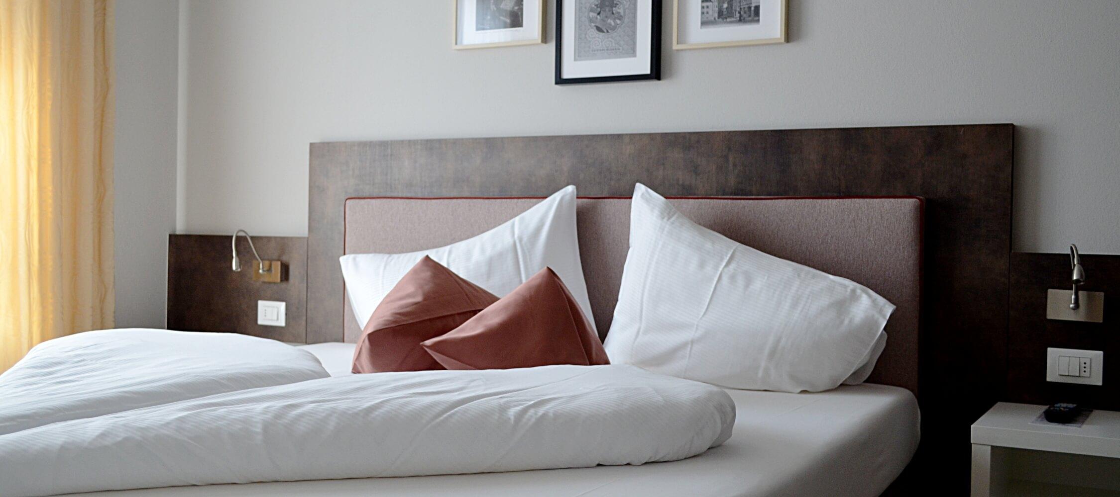 City_Hotel_Merano_Suite_Lifestyle_Schlafzimmer_Detail_0590_2250x1000
